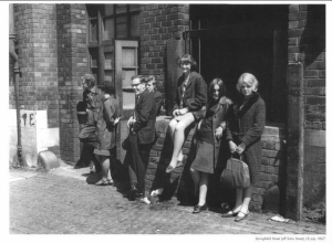 Young people on Springfield Road, inner city Liverpool, 1964